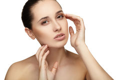 Beautiful young woman with clean skin of the face Royalty Free Stock Image