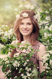 Beautiful Young Woman with Clean Skin and White Flowers Stock Photos