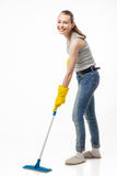 Beautiful young woman cleaning floor with mop Royalty Free Stock Photos