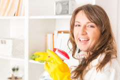 Beautiful young woman cleaning her house royalty free stock images
