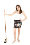 Beautiful young woman with cleaning sweep Stock Images