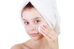 Beautiful young woman cleaning tampon the skin on face after bath in towel on the hand isolated on white background. royalty free stock photos