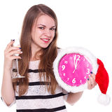 Beautiful young woman with clock and glass of champagne Royalty Free Stock Images