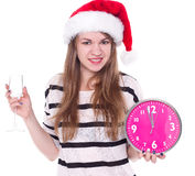 Beautiful young woman with clock and glass of champagne Stock Images