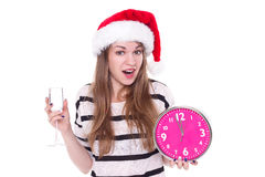 Beautiful young woman with clock and glass of champagne Royalty Free Stock Image