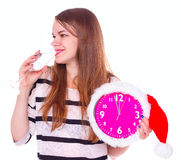 Beautiful young woman with clock and glass of champagne Stock Photos