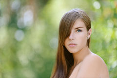 Beautiful young woman close up. Portrait of beautiful young woman close up, against green of summer park Royalty Free Stock Photos