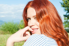 Beautiful young woman close-up on green summer meadow Stock Photo