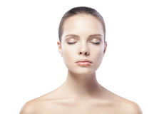Beautiful young woman with closed eyes isolated Stock Image