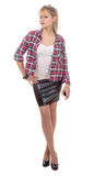Beautiful young woman clothed in a leather skirt and shirt. On white Stock Photos