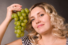 Beautiful young woman with the cluster of vine Royalty Free Stock Photography