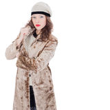 Beautiful young woman in a coat. On white background Royalty Free Stock Images