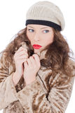 Beautiful young woman in a coat. On white background Stock Photo