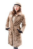 Beautiful young woman in a coat. On white background Stock Image
