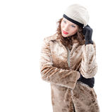 Beautiful young woman in a coat. On white background Royalty Free Stock Photography