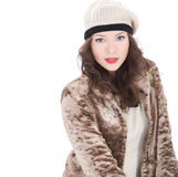 Beautiful young woman in a coat. On white background Stock Photos