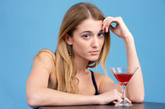 Beautiful young woman with cocktail Stock Image