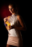 Beautiful young woman with cocktail  over black Royalty Free Stock Photo