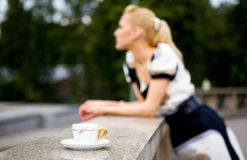 Beautiful young woman and coffee. Blond lovely young woman drinking coffee outside Royalty Free Stock Images