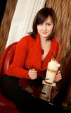 Beautiful young woman with coffee cocktail in cafe Royalty Free Stock Image