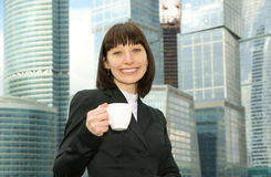 Beautiful young woman with coffee cup Royalty Free Stock Images