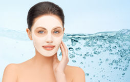 Beautiful young woman with collagen facial mask Stock Photo