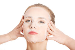 Beautiful young woman with collagen mask. Royalty Free Stock Image