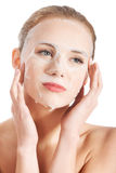 Beautiful young woman with collagen mask. Stock Photo