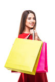 Beautiful young woman with color shoping bags in hands on white background Stock Photo