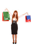 Beautiful young woman with color shopping bags Royalty Free Stock Image