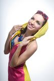 Beautiful young woman in color wear Royalty Free Stock Image