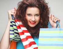 Beautiful young woman with colored shopping bags Royalty Free Stock Image