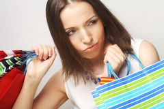 Beautiful young woman with colored shopping bags Stock Photo