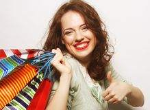 Beautiful young woman with colored shopping bags Stock Photography