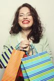 Beautiful young woman with colored shopping bags Royalty Free Stock Photo