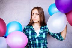 Beautiful young woman with air balloons standing near pink wall royalty free stock photos