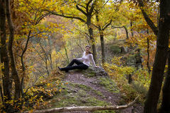 Beautiful young woman in a colorful autumn park Stock Photo