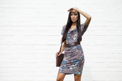 Beautiful young woman in colorful dress Stock Photo