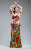 Beautiful young woman in colorful dress dancing Royalty Free Stock Photos
