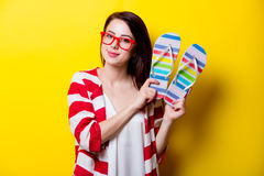 Beautiful young woman with colorful sandals standing in front of Royalty Free Stock Image