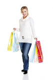 Beautiful, young, woman with colorful shopping bag Royalty Free Stock Photo