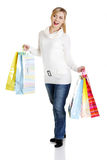 Beautiful, young, woman with colorful shopping bag Royalty Free Stock Image