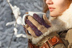 Beautiful young woman in colorful striped knitted mittens and co Royalty Free Stock Photos