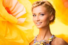 Beautiful young woman in colourful dress Royalty Free Stock Photo