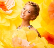 Beautiful young woman in colourful dress Royalty Free Stock Photography