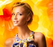 Beautiful young woman in colourful dress Stock Images