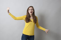 Beautiful young woman complaining like in theater Royalty Free Stock Photography