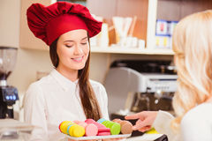 Beautiful young woman in a confectionery Royalty Free Stock Photos