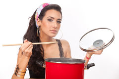 Beautiful young woman cook Stock Images