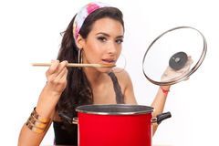 Beautiful young woman cook Stock Photos